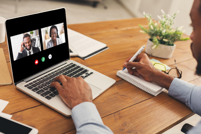 unrecognizable-black-man-watching-business-webinar-6PHHUTU-1